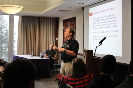 Photo by Hui Li '21. Prof. Matheson presents his research on stadium financing and what the Woo Sox mean for Worcester.