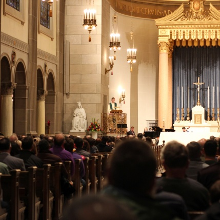 Photo by Hui Li '21. Father Boroughs presides over Mass on Sunday.