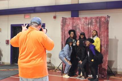 "Photo by Hui Li '21. Friends smile for the camera during ""Happening in the Fieldhouse."""