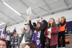 Photo by Hui Li '21. Crusaders celebrate a goal during the hockey game.
